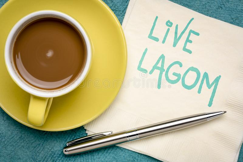 Live Lagom - Swedish philosophy for balanced life. Live Lagom, not too little, not too much, just right - Swedish philosophy for a balanced life, handwriting on stock image