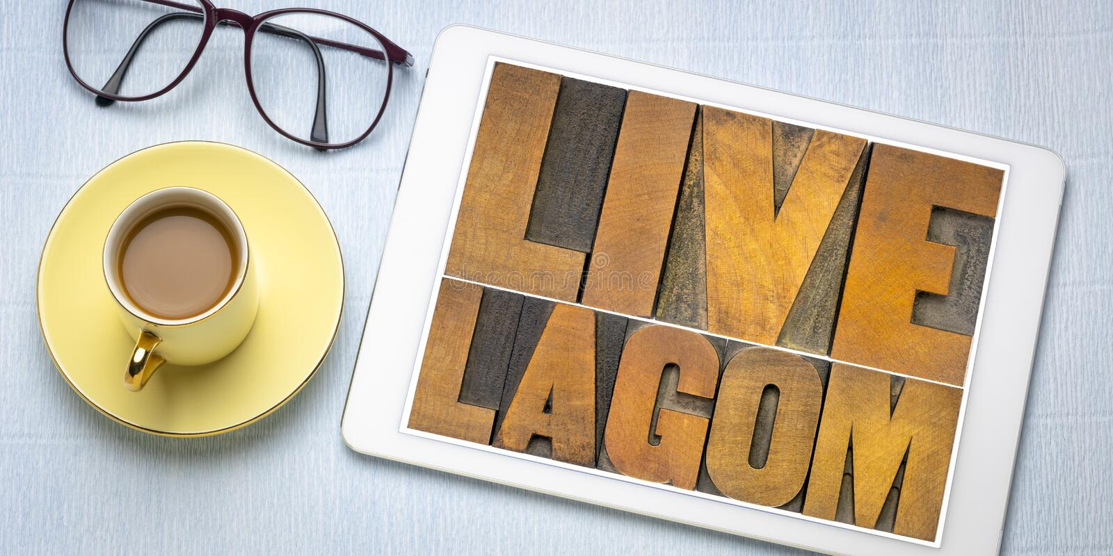 Live lagom word abstract in wood type royalty free stock photography