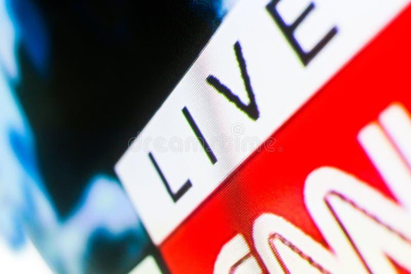 Live Lettering en el fondo blanco de la pantalla de la televisión fotos de archivo