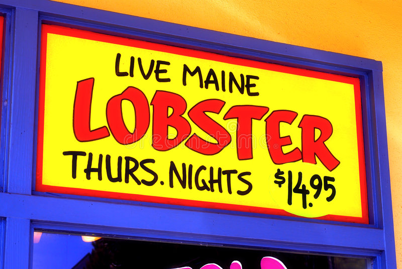 Live Maine Lobster. Thursday Nights $14.95 sign hand painted on a restaurant window stock images