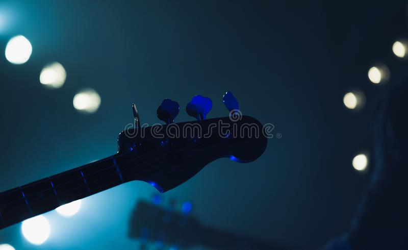 Live music background, electric bass guitar stock photography