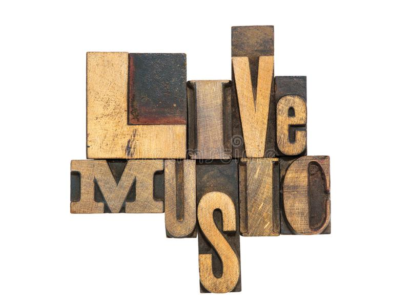 Live music isol. Live music phrase made from mixed wooden letterpress type isolated on white stock photo