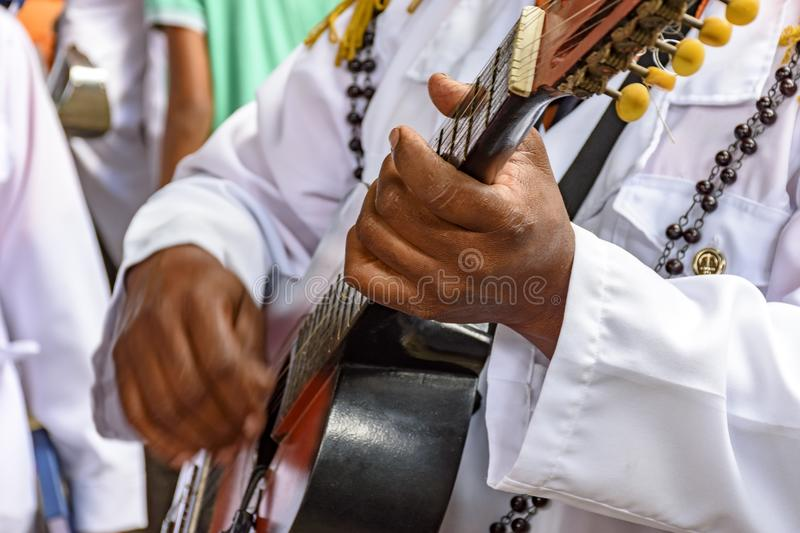 Live musical acoustical guitar performance of Brazilian popular music. During popular religious brazilian festival acoustic guitar royalty free stock images