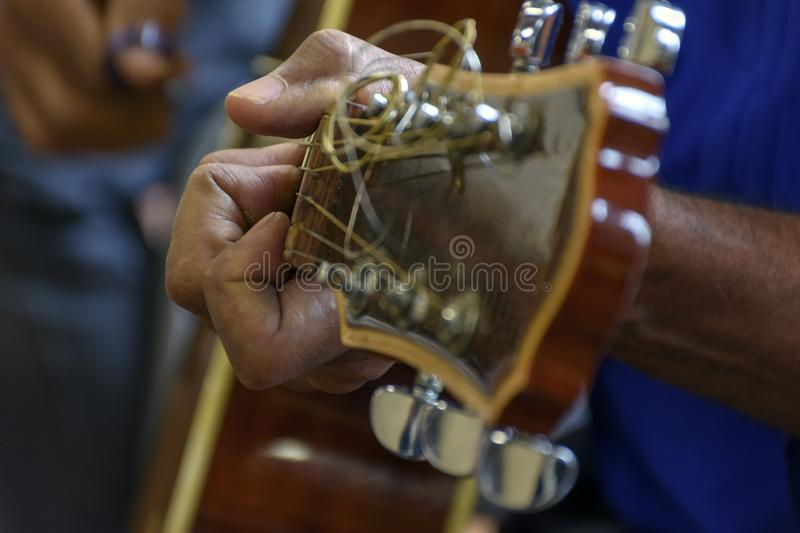 Live musical performance with acoustic guitar. Live musical performance of Brazilian popular music with acoustic guitar royalty free stock image