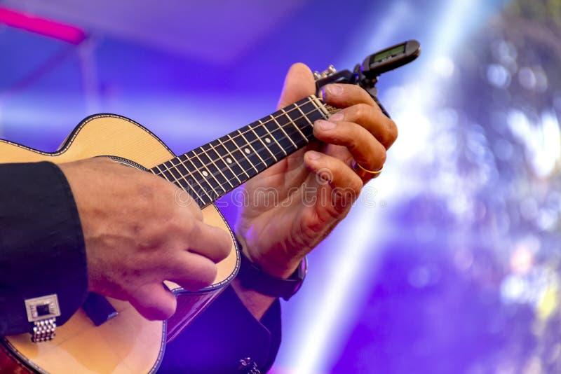 Live musical performance of Brazilian popular music called chorinho with four strings guitar. Live musical performance of Brazilian popular musialled chorinho stock photography
