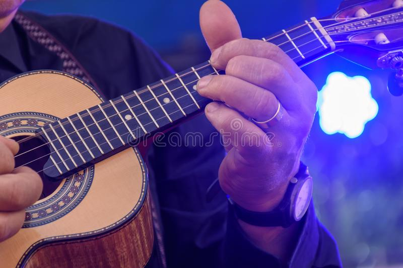 Live musical performance of Brazilian popular music. Called chorinho with little acoustic guitar with four strings stock image