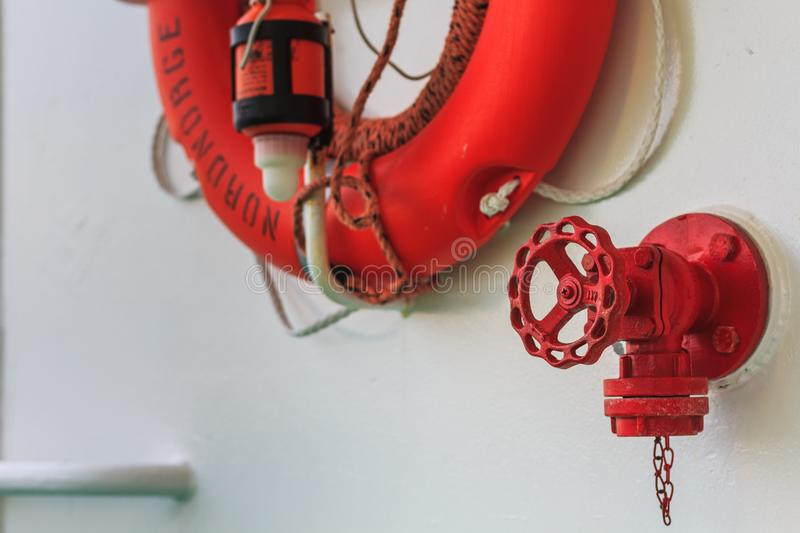 Live saver attached at nordnorge hurtigruten ship. In norway royalty free stock images