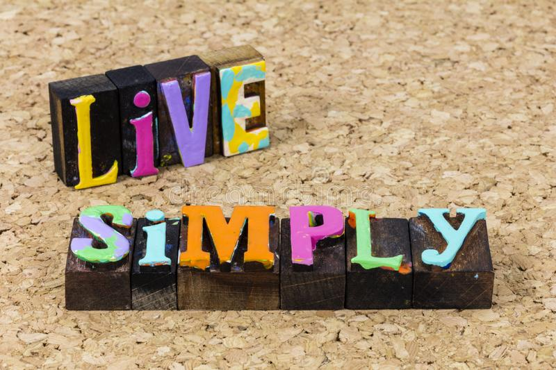 Live simply simple basic life style expression help kindness happy. Live simply simple basic family life style expression help kindness happy typography quote stock photos