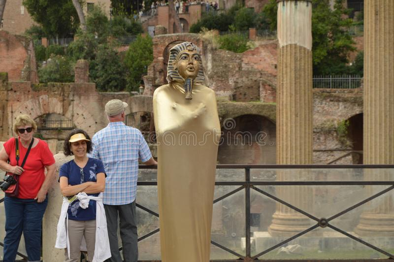 Live statue of Egyptian Pharaoh in the center of Rome surrounded by happy and cheerful tourists, October 7, 2018, Rome stock image