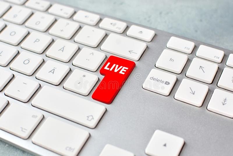 Live stream concept with keyboard and red key. royalty free stock images