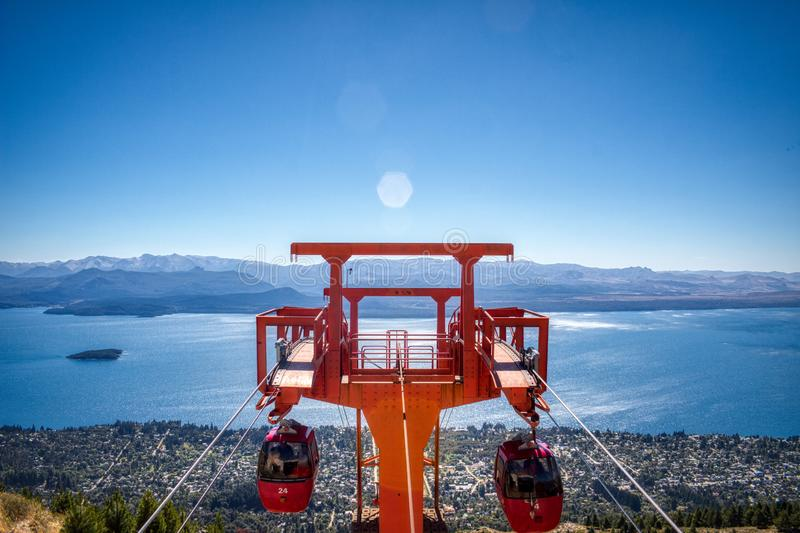 A live view of the chairlifts in the tower. Red tower of the chairlift in the top of the mountain royalty free stock photography
