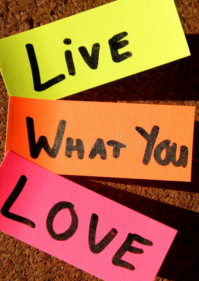 Live what you love!. Sticky notes forming text - live what you love stock image