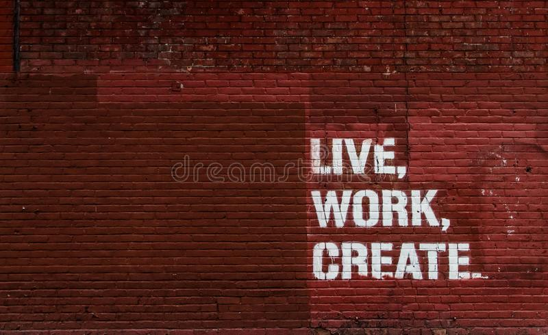Live, Work, Create ... Wall Background stock photo