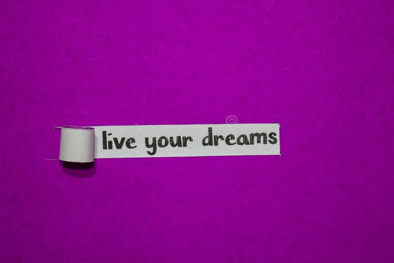 Live your Dreams, Inspiration, Motivation and business concept on purple torn paper stock photos