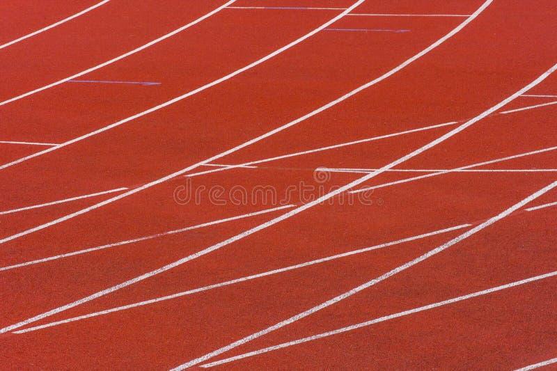 Livello di gomma della pista corrente dello stadio di atletica fotografia stock libera da diritti