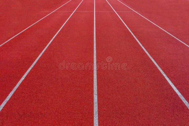 Livello di gomma della pista corrente dello stadio di atletica immagini stock libere da diritti