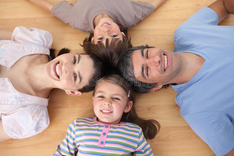 Download Lively Family Lying On The Floor Stock Photo - Image: 12401884