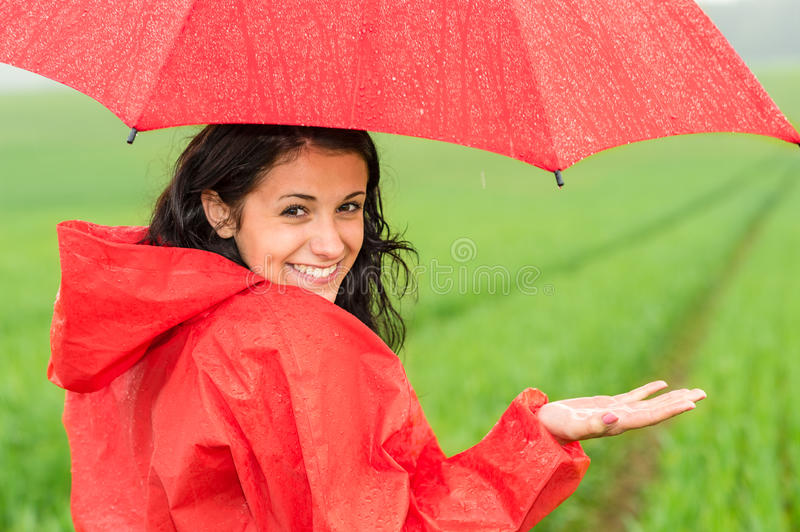 Lively teenager girl in the rain stock photo