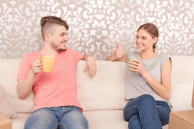 Lively young couple drinking tea royalty free stock images