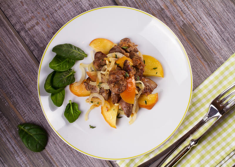 Liver with apple, spinach and onion. stock photos