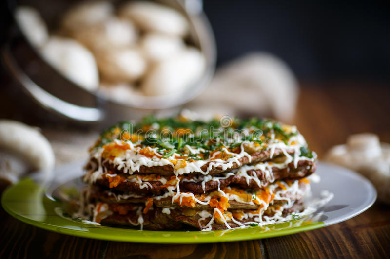 Liver cake stuffed with vegetables stock photos