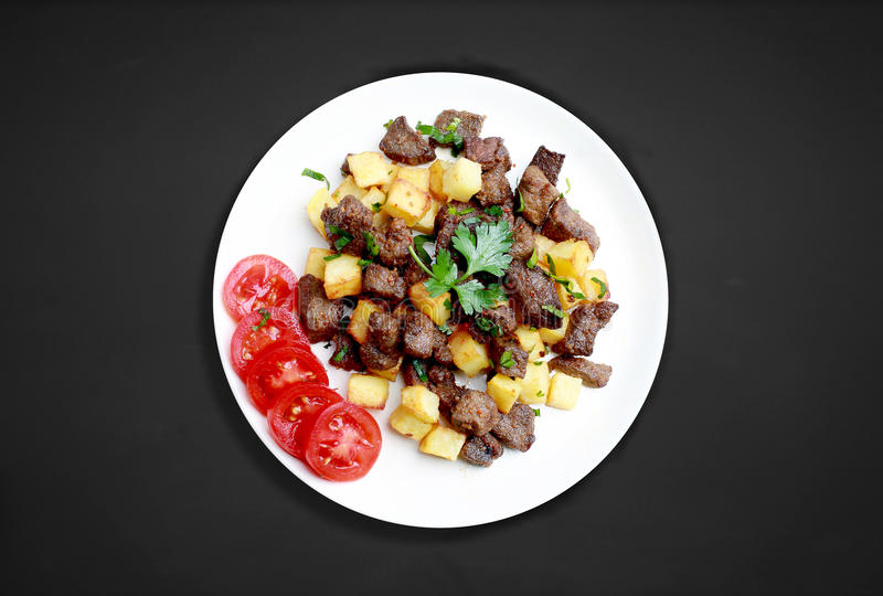 Liver cubes with potatoes royalty free stock images