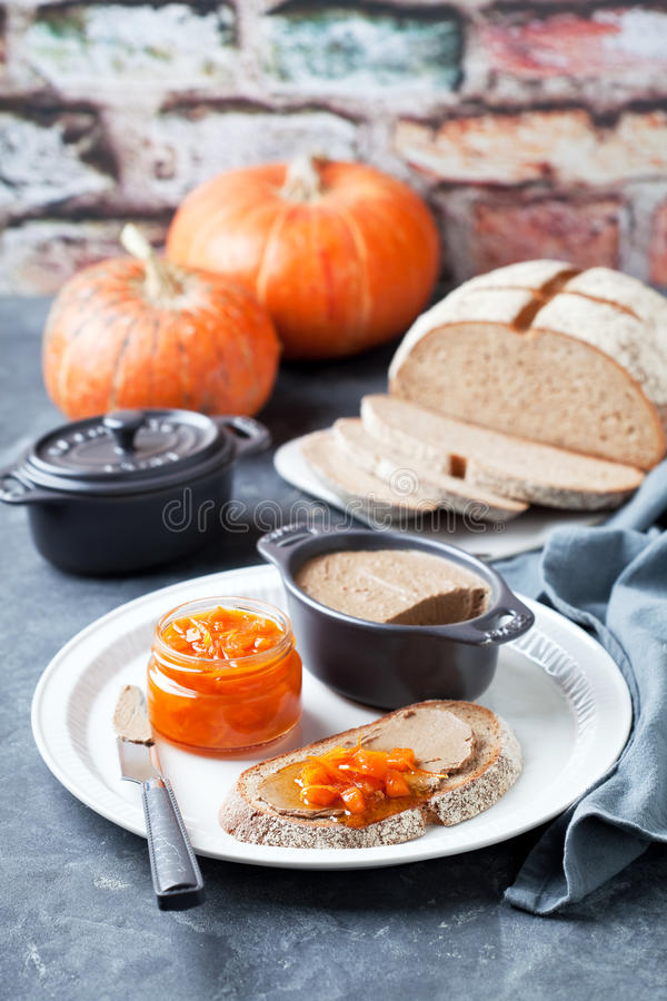 Liver pate and pumpkin orange marmalade royalty free stock photography