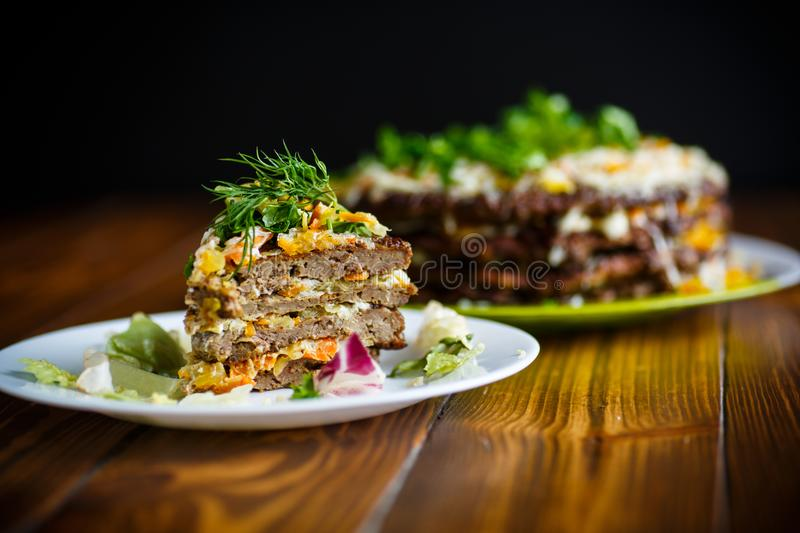 Liver pie layer cake stuffed with carrots royalty free stock image