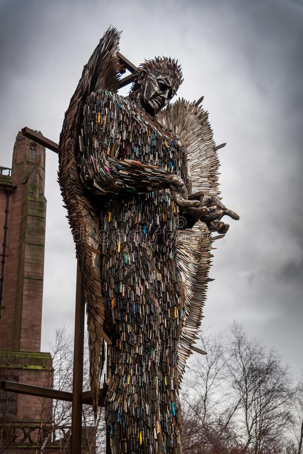 LIVERPOOL, ENGLAND, DECEMBER 27, 2018: Sculpture of an angel made with all kind of knives at the entrance of the Church of England. Anglican Cathedral of the stock photo