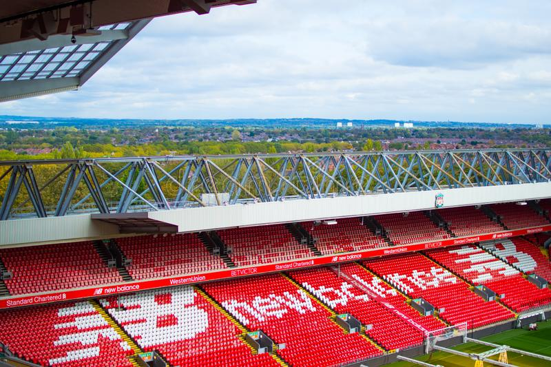 Liverpool, England, United Kingdom; 10/15/2018: Empty red steps or terraces of Anfield, Liverpool`s FC Stadium, during a tour.  royalty free stock photo