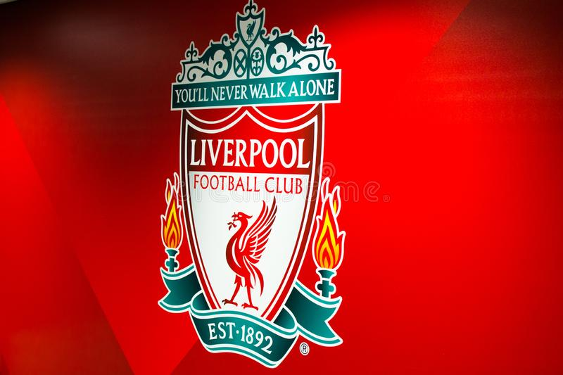 Liverpool, England, United Kingdom; 10/15/2018: Liverpool`s FC badge or emblem with red background inside of Anfield Stadium.  stock photos