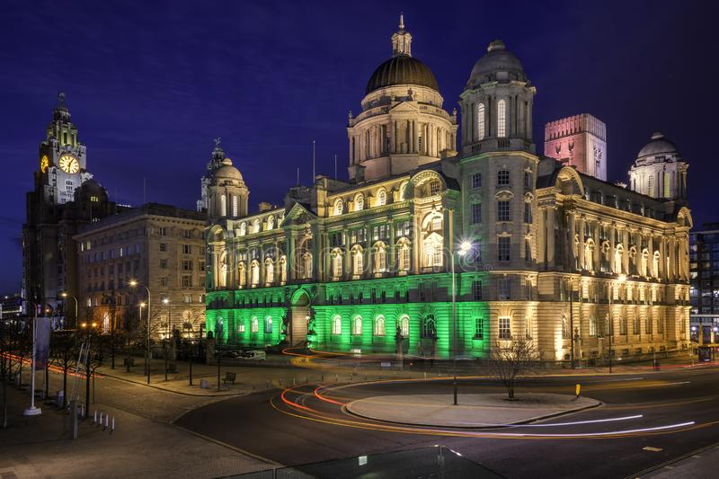 Liverpool 3 Graces waterfront. Liverpool three graces lights up at night along the waterfront and pier head royalty free stock photo