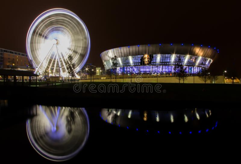 Liverpool, Merseyside / United Kingdom - November 7, 2011: A night long exposure of the Spinning Wheel at The Echo Arena.  royalty free stock photography