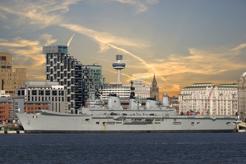 Liverpool Skyline. Liverpool Waterfront with the Royal Navy Ship Ark Royal berthed on the docks showing the famous Liverbirds stock photography