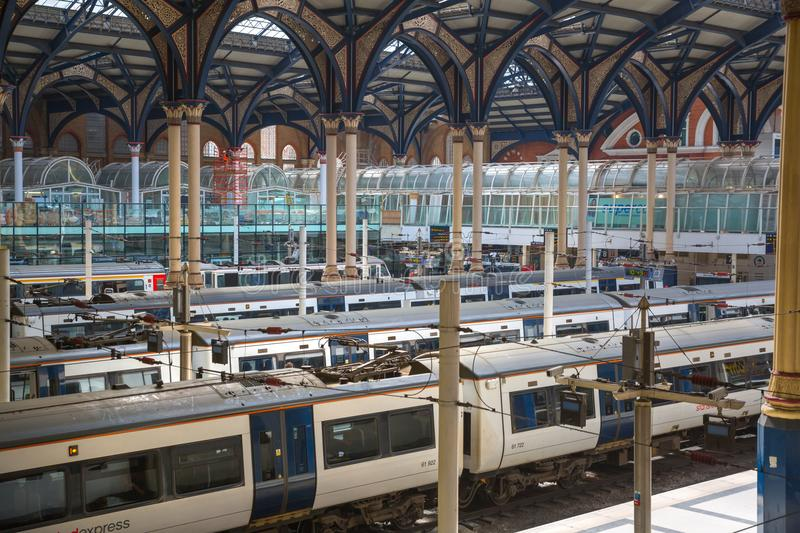 Liverpool street train station interior Trains on the platforms ready to depart. UK. LONDON, UK - 17 May, 2016: Liverpool street train station interior Trains on stock photo