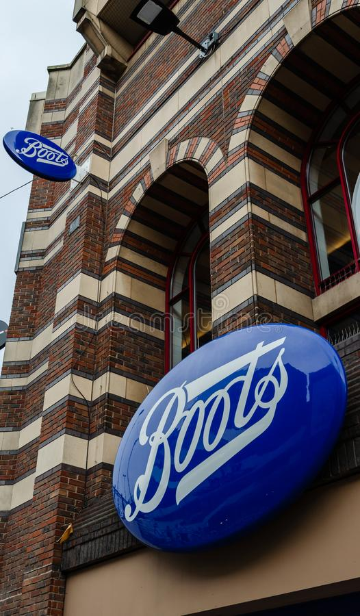 Boots shop sign stock images