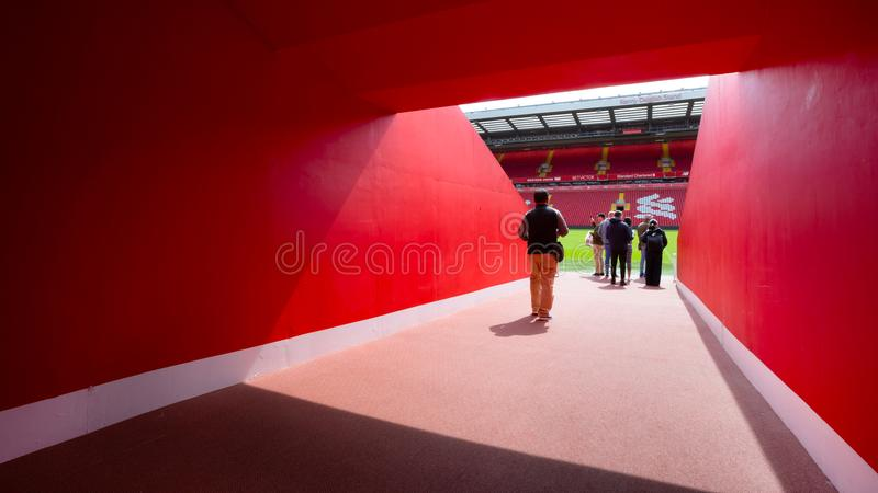 LFC staffs and a group of football fans in Anfield stadium, Liverpool, UK. LIVERPOOL, UNITED KINGDOM - MAY 17 2018: LFC staffs and a group of its football fans royalty free stock photo