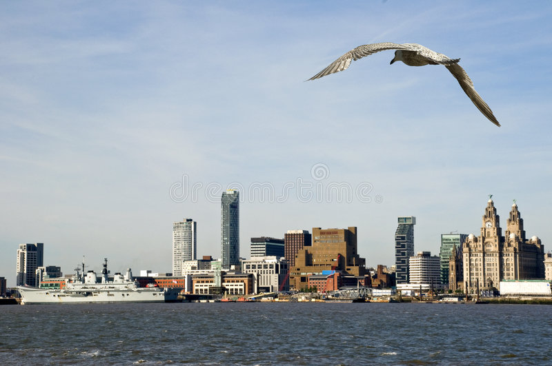Liverpool Waterfront. With the Royal Navy Ship Ark Royal berthed on the docks showing the famous Liverbirds stock photography