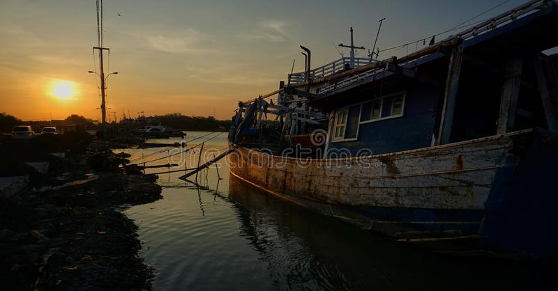 The lives of fishermen on the coast of the sea. The lives of fishermen on the sea coast, fishing, making boats and fishing are the work of Indonesian fishermen royalty free stock photos