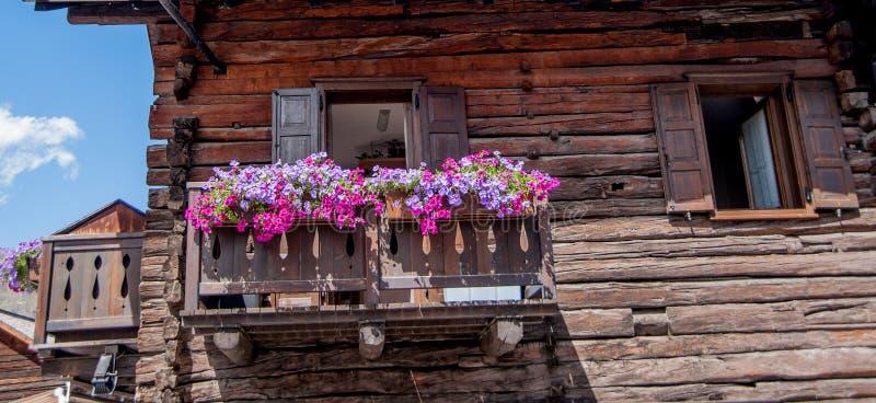 Livigno flowered. Balcony ornamental balconies royalty free stock photo