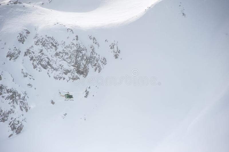 Livigno Italy, snow covered mountains with Helicopter. Livigno is a ski resort in the Italian Alps, near the Swiss border. It`s known for its snow parks, with royalty free stock photo