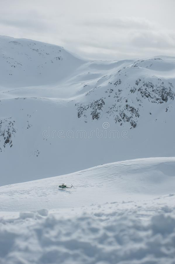 Livigno Italy, snow covered mountains with Helicopter. Livigno is a ski resort in the Italian Alps, near the Swiss border. It`s known for its snow parks, with royalty free stock image