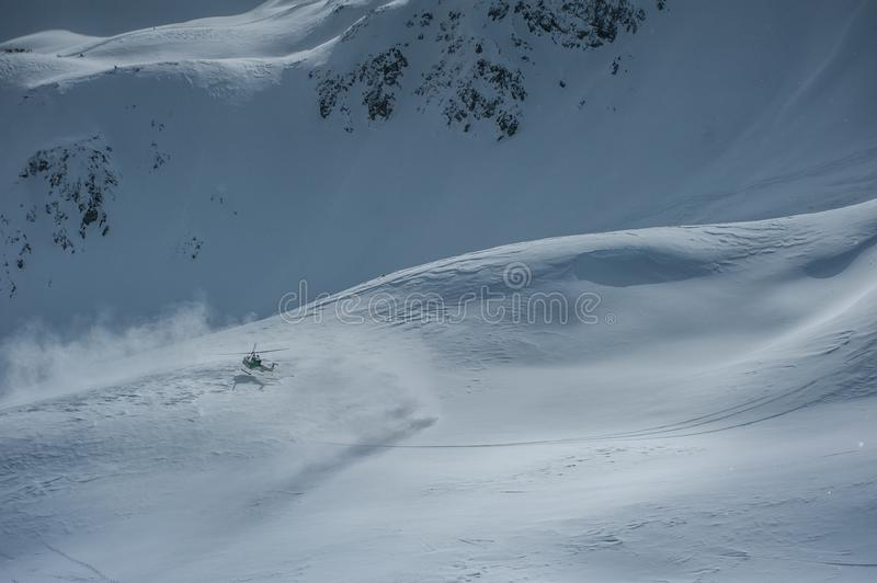 Livigno Italy, snow covered mountains with Helicopter. Livigno is a ski resort in the Italian Alps, near the Swiss border. It`s known for its snow parks, with stock image