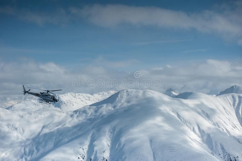 Livigno Italy, snow covered mountains with Helicopter. Livigno is a ski resort in the Italian Alps, near the Swiss border. It`s known for its snow parks, with royalty free stock images