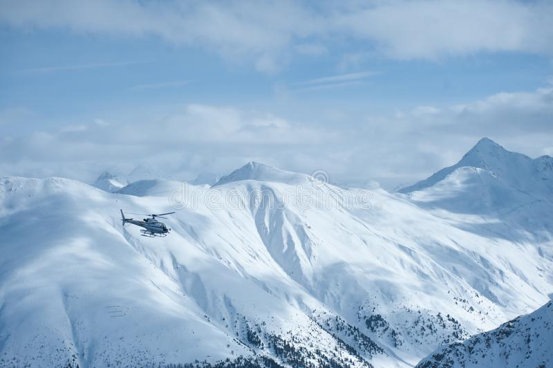Livigno Italy, snow covered mountains with Helicopter. Livigno is a ski resort in the Italian Alps, near the Swiss border. It`s known for its snow parks, with royalty free stock photos