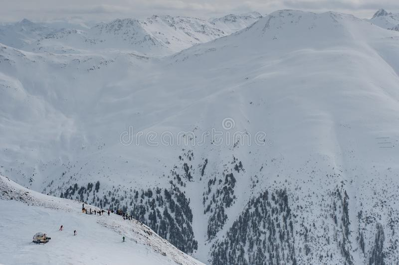 Livigno Italy, snow covered mountains. Livigno is a ski resort in the Italian Alps, near the Swiss border. It`s known for its snow parks, with slopes and trails stock photography