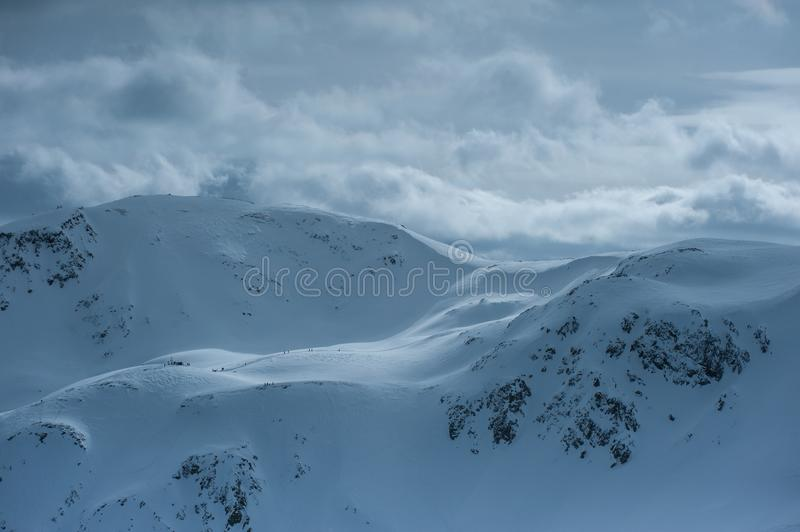 Livigno Italy, snow covered mountains. Livigno is a ski resort in the Italian Alps, near the Swiss border. It`s known for its snow parks, with slopes and trails stock photos