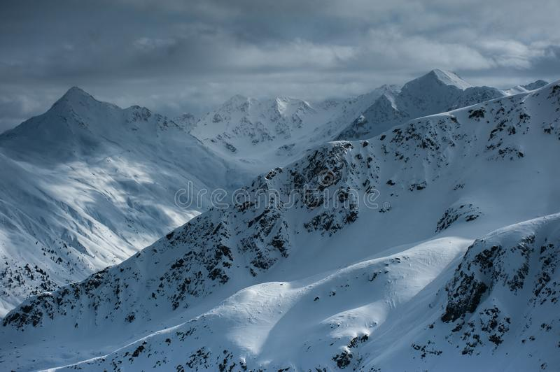 Livigno Italy, snow covered mountains. Livigno is a ski resort in the Italian Alps, near the Swiss border. It`s known for its snow parks, with slopes and trails royalty free stock images