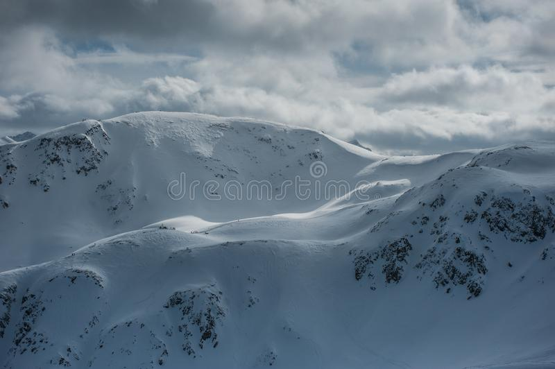Livigno Italy, snow covered mountains. Livigno is a ski resort in the Italian Alps, near the Swiss border. It`s known for its snow parks, with slopes and trails stock image