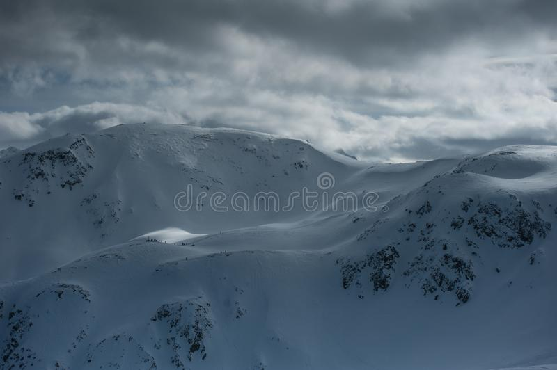Livigno Italy, snow covered mountains. Livigno is a ski resort in the Italian Alps, near the Swiss border. It`s known for its snow parks, with slopes and trails stock photo